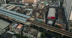 Timelapse of traffic on road and skytrain at bangkok stock video footage