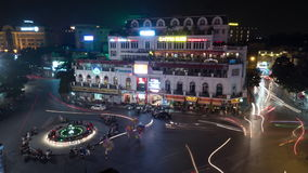 Timelapse of traffic on square in Hanoi at night, Vietnam. HANOI, VIETNAM - OCTOBER 27, 2015: Timelapse shot of city central square at night. Traffic with red stock footage
