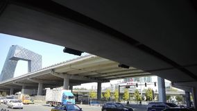 Timelapse traffic under overpass in city. stock video footage