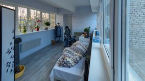 Timelapse transition from night to early morning to day indoors, person sleeping stock footage