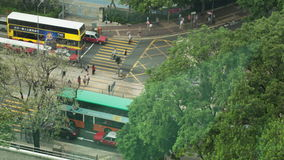 Timelapse of transport and pedestrian traffic on Hong Kong road. HONG KONG - NOVEMBER 09, 2015: Timelapse high angle shot of cars and trams traffic, pedestrian stock footage