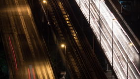 Timelapse of transport trails and empty railway in night city stock video footage