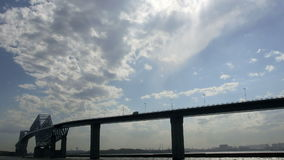 Timelapse of transportation and cloudscape around a bridge above the ocean. stock footage