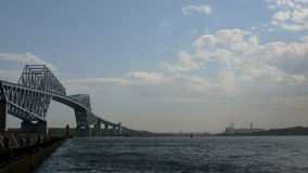 Timelapse of transportation and cloudscape around a bridge above the ocean. stock video footage