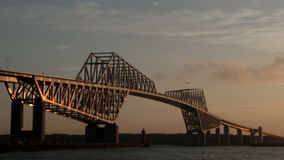 Timelapse of transportation and cloudscape around a bridge above the ocean. stock video