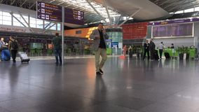 Timelapse of travelers in an airport stock footage