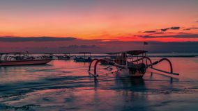 Timelapse Tropical island sunset with traditional Bali boat in Nusa Lembongan, Indonesia. 4K Timelapse in Nusa Lembongan and Nusa Ceningan Island, Bali stock video footage