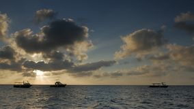 Timelapse of tropical sunset. A view of sunset over a tropical sea stock video footage