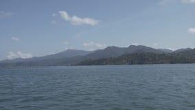 Timelapse, Tropical Thai jungle lake Cheo lan, island, wild mountains nature national park ship yacht rocks. Tropical exotic green wild mountains sinset jungles stock footage