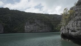 Timelapse Tropical Thai jungle lake, island, wild mountains nature national park ship yacht rocks. Tropical exotic green wild mountains sinset jungles on stock footage