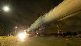 Timelapse Trucks with Lights Drive along Night Road stock video footage