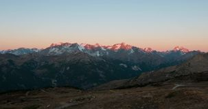 Timelapse from twilight to day on the the Alps. The majestic glaciers and mountain peaks of the Massif des Ecrins, over 4000 m, Fr. Ance stock video footage