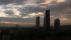 Timelapse Urban City Skyline At Dusk, Malaysia, 4K UHD. Timelapse high vantage point of clear urban cityscape at dusk, Selangor, Malaysia in 4K UHD stock video footage