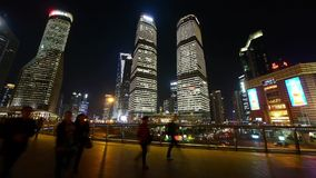Timelapse,urban traffic & people sketch at night,Brightly lit modern building. stock footage