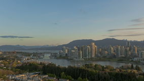 Timelapse Vancouver Skyline. Timelapse sunrise at Vancouver Skyline with boats on the river stock video footage