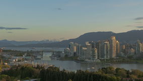 Timelapse Vancouver Skyline. Timelapse sunrise at Vancouver Skyline with boats on the river stock footage