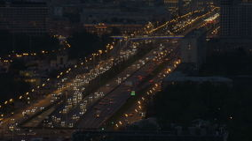 Timelapse. Very intense traffic on the streets of the city. In evening time. Wide road. View from the top point. stock video
