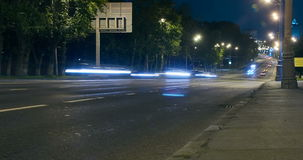 Timelapse video of automobile traffic on a city street in the night stock footage