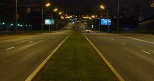 Timelapse video of automobile traffic on a city street in the night stock video footage
