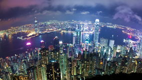 Timelapse video of a city at night, camera revolving stock video footage