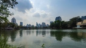 Clouds moving over city. Timelapse video of clouds moving Bangkok city at Lumpini Park, Thailand stock video footage