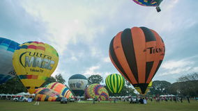 Timelapse video of colorful hot air balloons launch stock footage