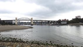 A timelapse video of English Bay and Burrard Street Bridge.  stock video