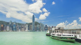 Timelapse video of ferry terminal and Victoria Harbour in Hong Kong stock video footage