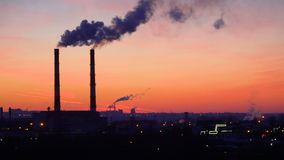 Timelapse video of oil refinery and air pollution at sunset