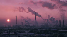 Timelapse Video of Oil Refinery Air Polution at Sunset. stock video footage
