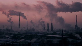 Timelapse Video of Oil Refinery Air Polution at Sunset.