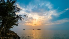 Timelapse video of sunset on beach. Timelapse video of sunset over the sea palm trees and yellow sky stock footage
