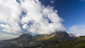 Timelapse video of Table Mountain with clouds passing over stock video footage