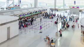 Timelapse video of travellers at the check-in counters of Hong Kong International Airport. stock video