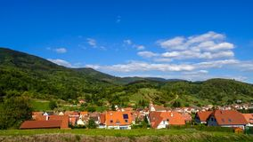 Timelapse view of clouds moving over the village, Alsace stock footage