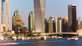Timelapse view of Dubai Marina skyscrapers with floating yachts and boats , United Arab Emirates. Timelapse view of Dubai Marina skyscrapers with floating yachts stock video