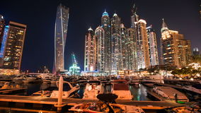 Timelapse view of Dubai Marina skyscrapers with floating yachts and boats , United Arab Emirates. Timelapse view of Dubai Marina skyscrapers with floating yachts stock footage