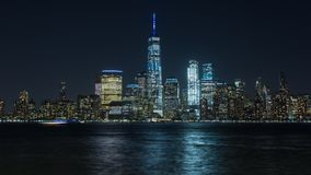 Timelapse view from Jersey city through Hudson river to Manhattan New York skyline in the night. Skycrapsers downtown, Freedom tower stock footage