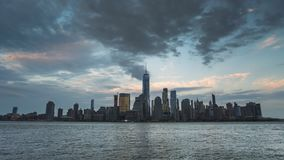 Timelapse view from Jersey city through Hudson river to Manhattan New York skyline on sunset stock footage