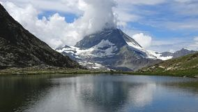 Timelapse view on Matterhorn peak and lake Stellisee, Swiss Alps, Zermatt, Switzerland. Summer landscape, sunshine weather, blue sky and sunny day stock video footage