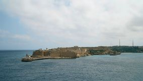 Timelapse View of the Mediterranean Sea, Fort Ricasoli and the island of Malta from the coast of Valletta. Timelapse View of the Mediterranean Sea, Fort stock footage