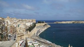 Timelapse view of the Mediterranean Sea, Valletta and the island of Malta from the coast of Valletta. Timelapse view of the Mediterranean Sea, Valletta and the stock video footage