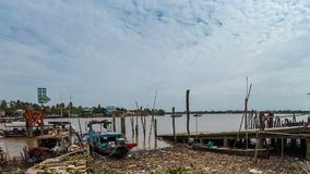 Timelapse  view of pier and local ferry boat. Carry people and vehicles across Mekong river at Cai Be, Vietnam stock video