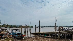 Timelapse view of pier and local ferry boat. Carry people and vehicles across Mekong river at Cai Be, Vietnam stock footage