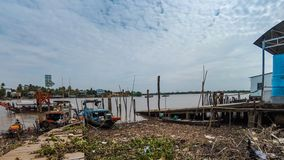 Timelapse view of pier and local ferry boat. Carry people and vehicles across Mekong river at Cai Be, Vietnam stock video footage