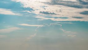 Timelapse view of rolling clouds in blue sky stock footage