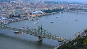 Timelapse view of ship traffic on the Danube river at Liberty bridge in central Budapest which splits the Buda and Pest parts of t stock video