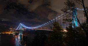 Vancouver Lionsgate Bridge Night Timelapse. Timelapse views of the Vancouver Lionsgate Bridge at night as clouds pass by stock video