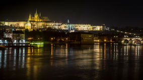 Timelapse of the Vltava and Charles Bridge in Prague by Night. A close-up night timelapse of the Charles Bridge, Prague Castle and Vltava River in Prague, Czech stock video