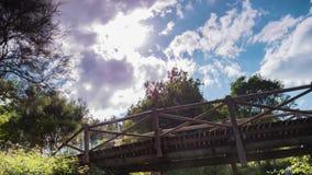 Timelapse von Wolken über einer Holzbrücke stock video footage